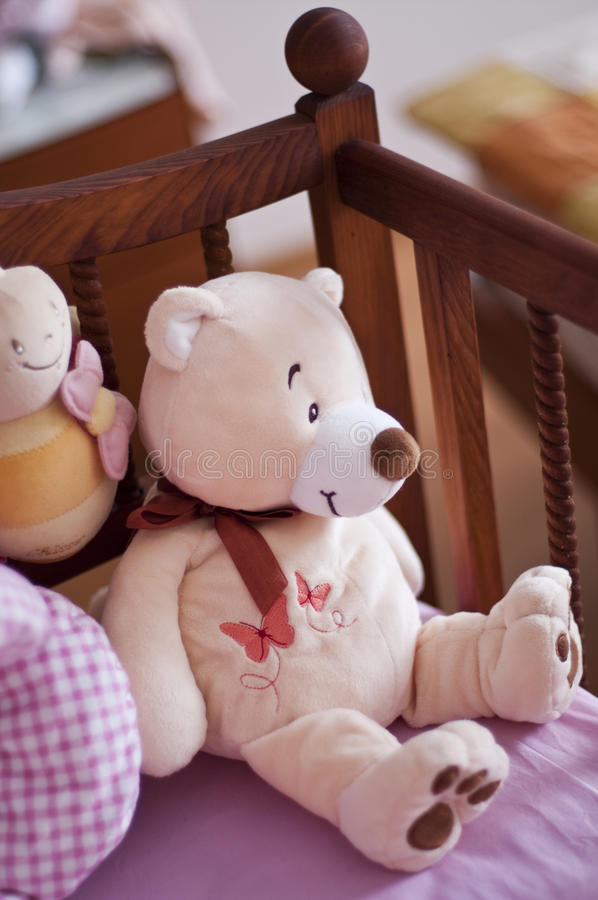 Baby bed with teddy bear. And others toys stock photo