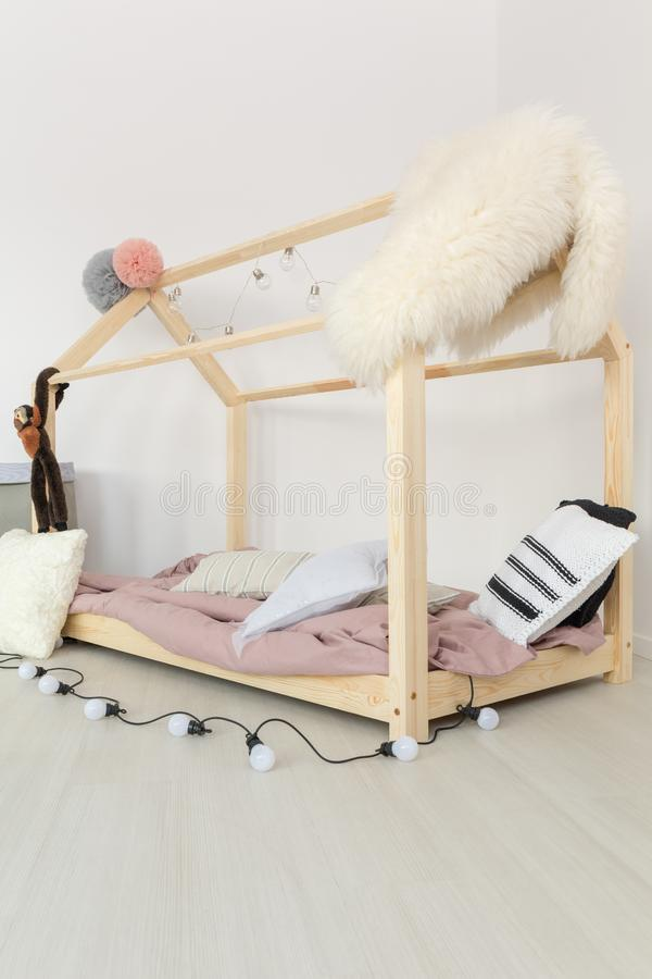 Baby bedroom with fluffy textiles royalty free stock photography