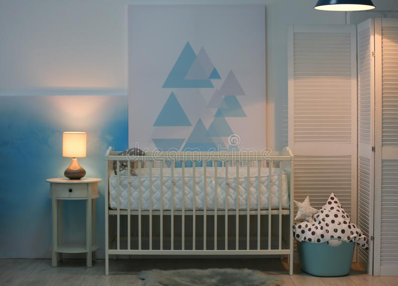 Baby bedroom interior with crib and beautiful decor. Elements royalty free stock images