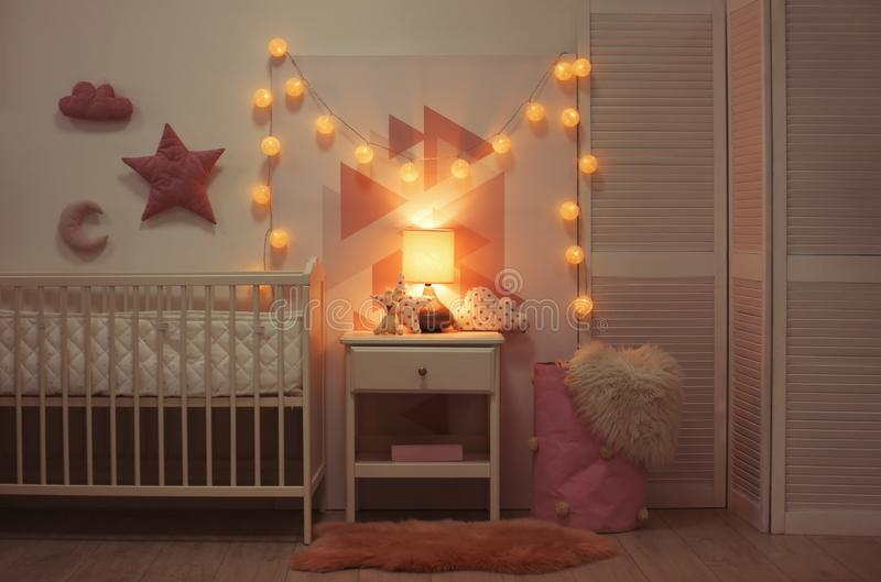 Baby bedroom interior with crib and beautiful decor. Elements stock photo