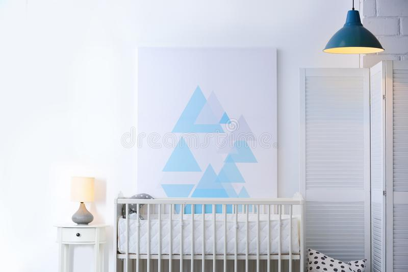 Baby bedroom interior with crib and beautiful decor. Elements stock images