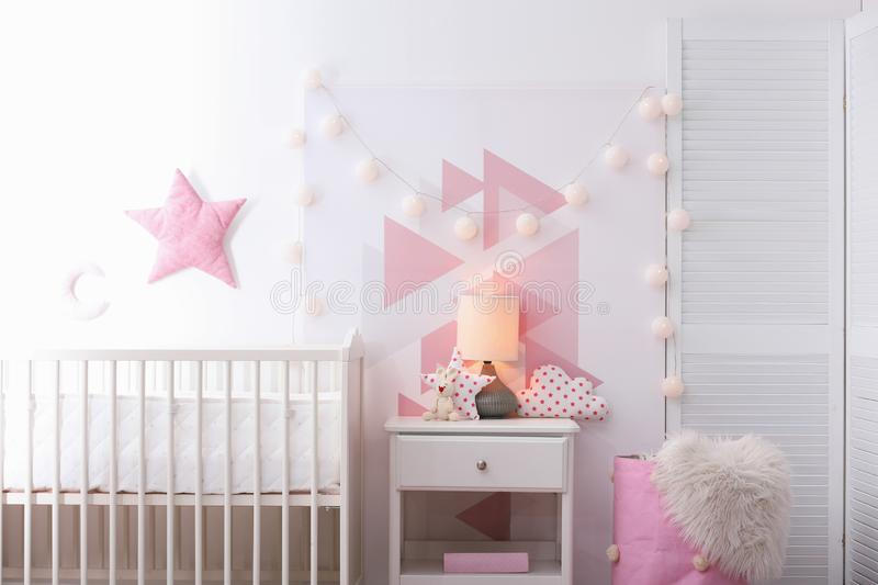 Baby bedroom interior with crib and beautiful decor. Elements royalty free stock photo