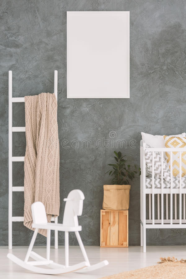 Baby bedroom with white cot royalty free stock images