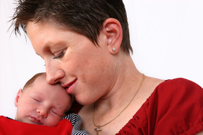 Baby being watch by loving mother stock photos