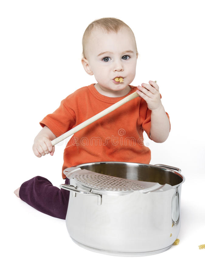 Baby With Big Cooking Pot Royalty Free Stock Image