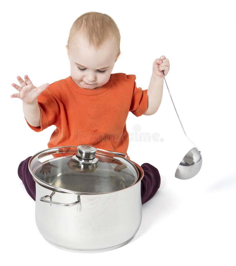 Baby with big cooking pot stock image