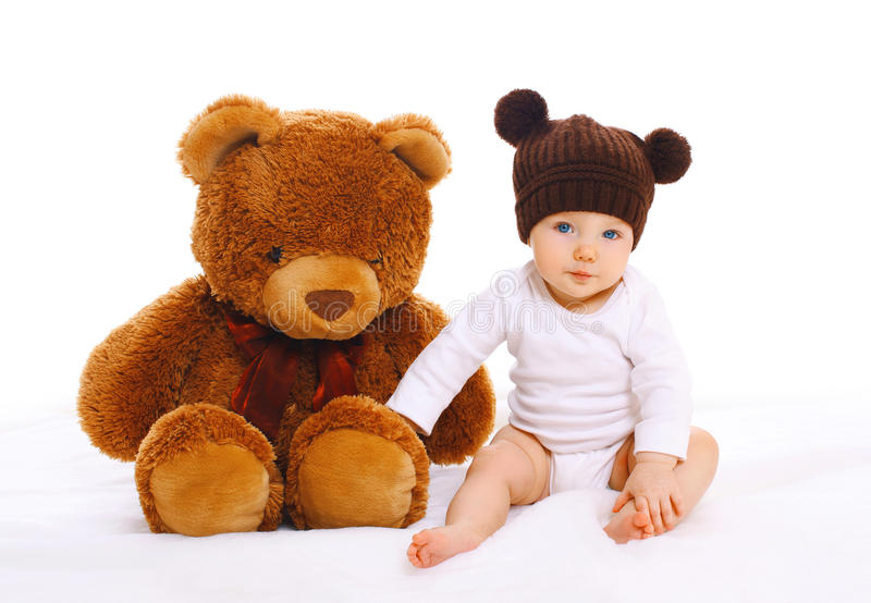 Baby with big teddy bear toy on white. Background stock images