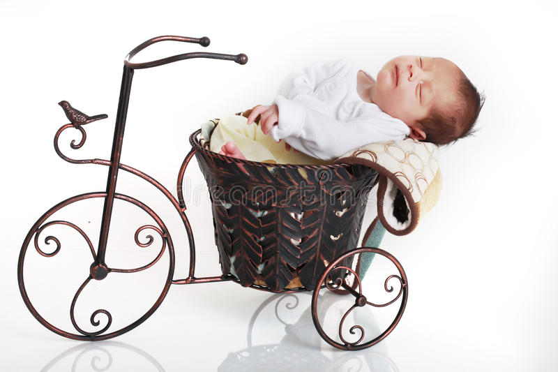 Download Baby on bike stock photo. Image of asleep, relax, arms - 11938542