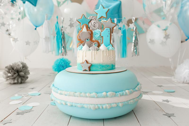 Baby birthday cake. Mint colors. In decorated room with paper garland and balloons stock photography