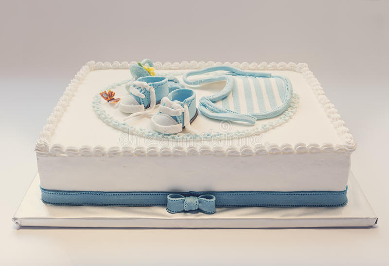 Baby birthday cake. Birthday cake for baby, blue and white design, on light gray background royalty free stock images