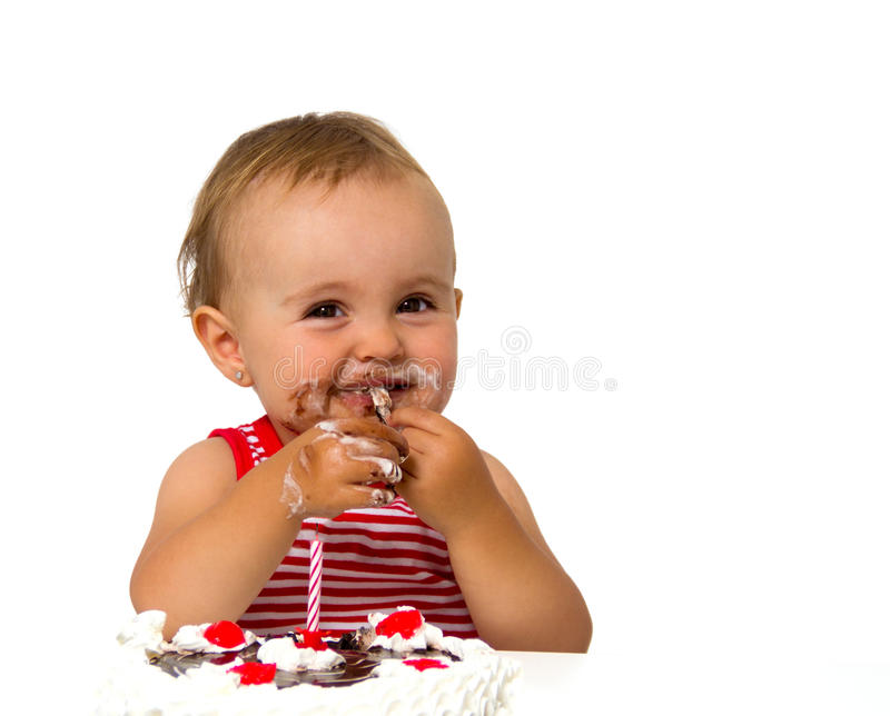 Baby with birthday cake. Isolated on white royalty free stock images