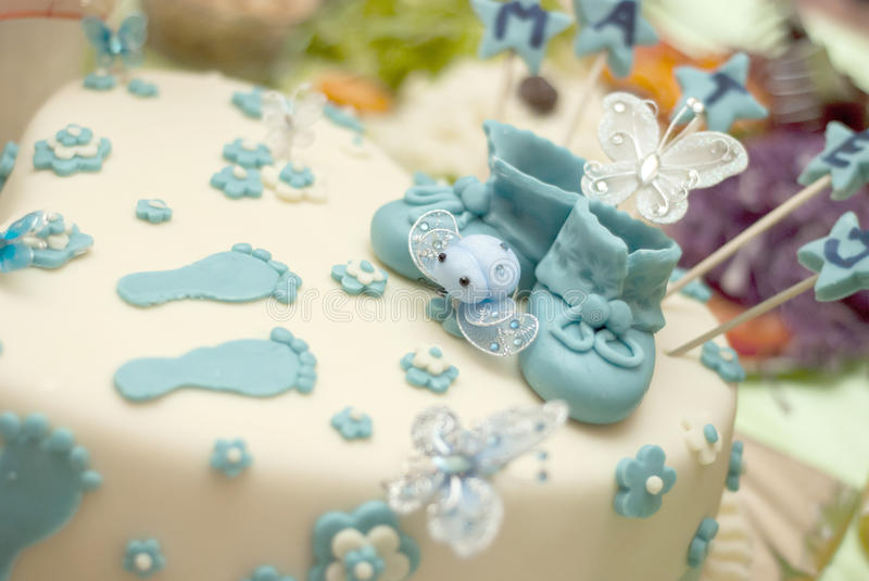 Baby boy birthday cake. Picture of a Baby boy birthday cake with cute shoes royalty free stock images