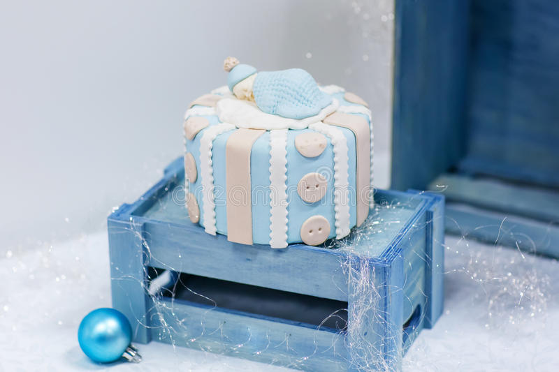 Baby birthday cake in soft blue and white. As gift for birth or christening party stock photography