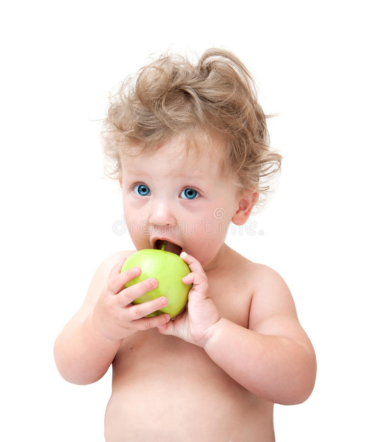 Baby biting a green Apple. On white background royalty free stock photography