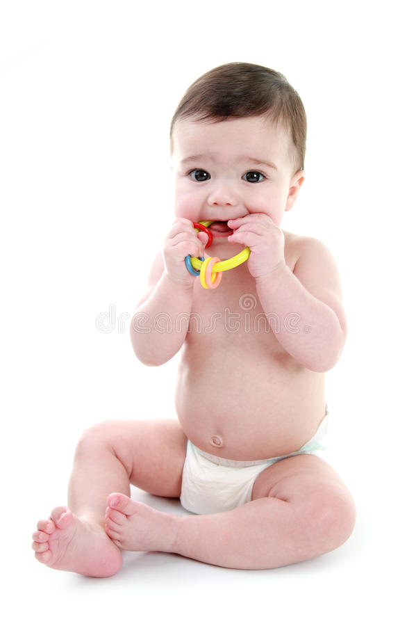 Baby biting teething ring. Isolated on white stock photography