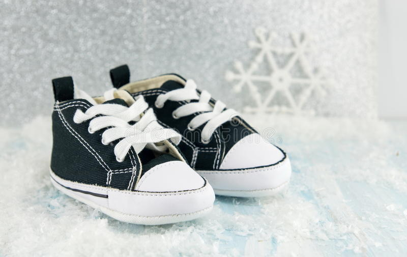 Baby black sneakers royalty free stock photo