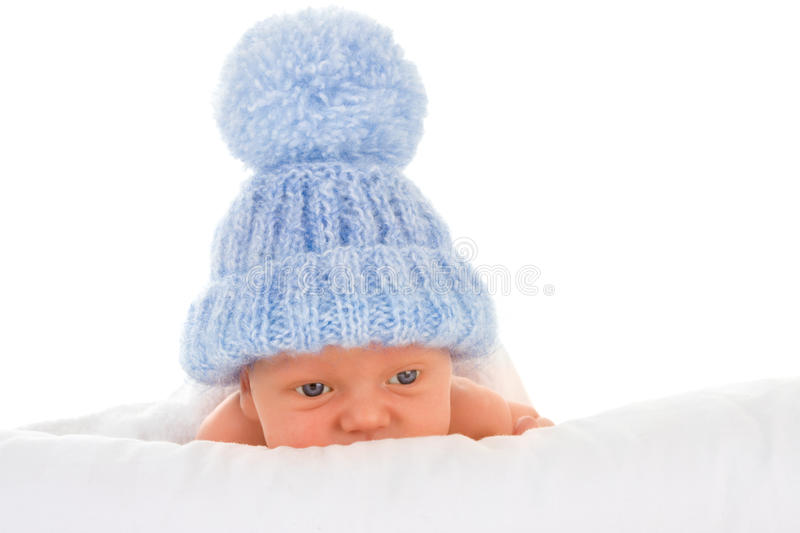 Baby in blue bobble hat royalty free stock photo