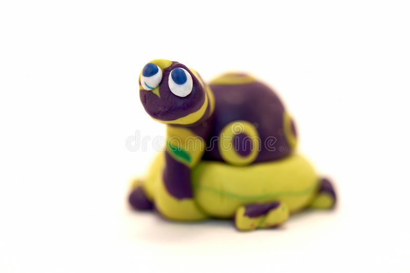 Baby blue eyes. Clay turtle with just his baby blue eyes in focus stock photography