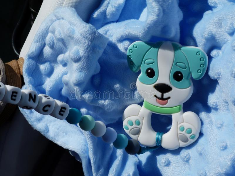 Baby blue fleece material and baby toys in bright sunshine stock photo