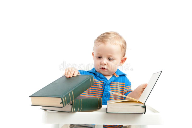 Baby with books. Little baby boy with books
