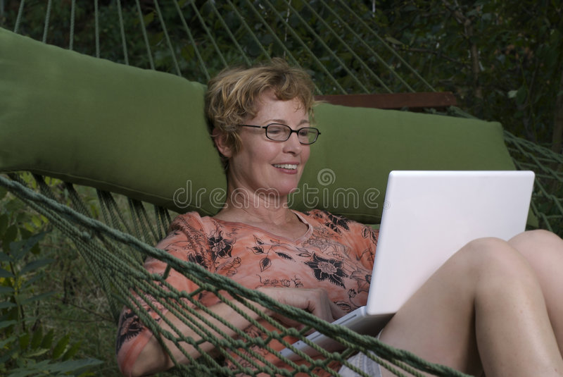 Baby Boomer Works At Home Royalty Free Stock Images