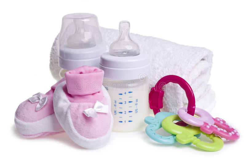 Baby booties, bottles and toy for teething stock photo