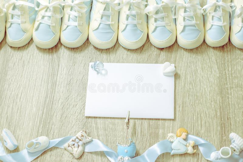 Baby booties for newborn boy shower party, store add or post card. Top view. Copy space. Framing stock photos