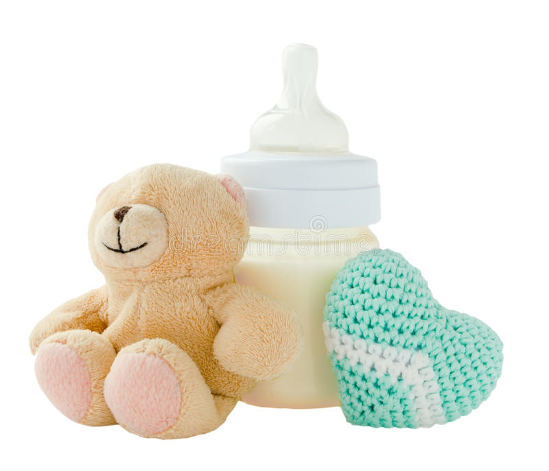 Baby bottle with milk and another products royalty free stock photography