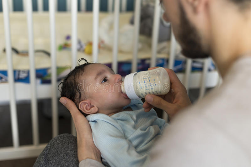 Baby bottle time stock photography