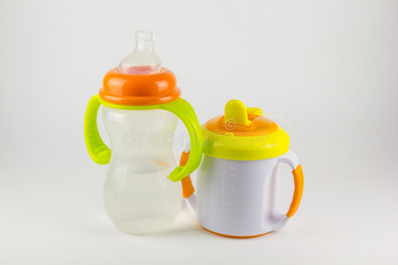 Baby bottles with water on white background royalty free stock photos