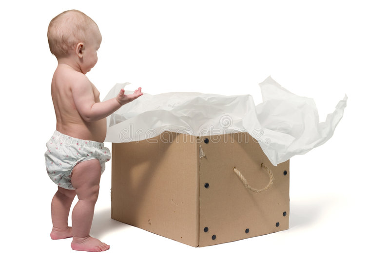 Baby and the box. Baby standing next to the big box. Isolated on white, with copy space stock photo