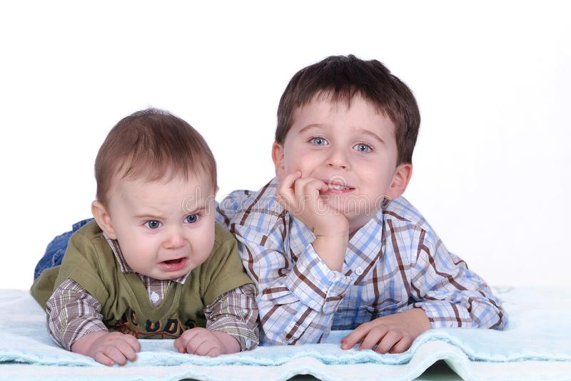 Baby and boy stock image