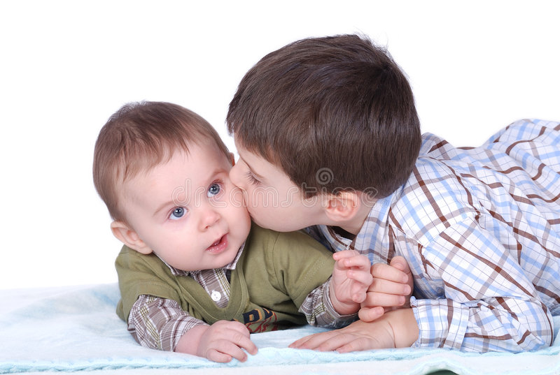 Baby and boy stock photography