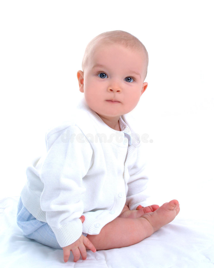 Baby boy. Sitting in front of white background royalty free stock image