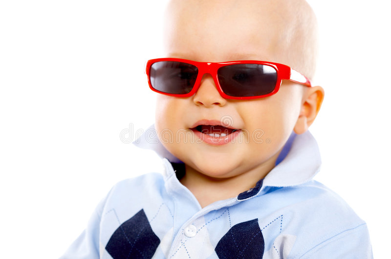 Baby Boy. Portrait of sweet little baby boy with sunglasses royalty free stock photos