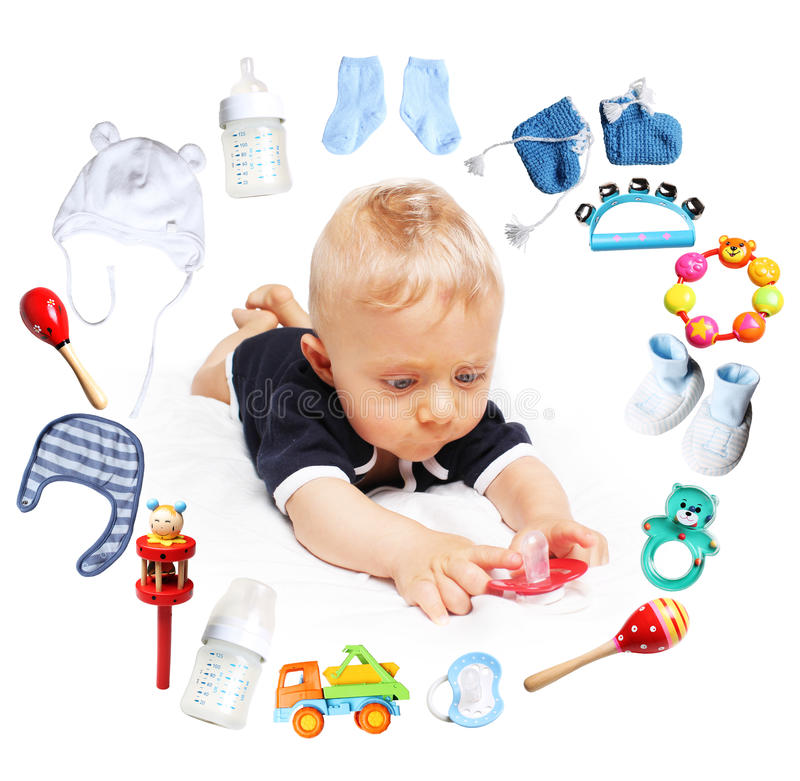 Baby boy and accessories for children in a circle around. White background stock photography