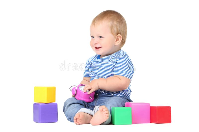Baby boy with toy cubes stock photo