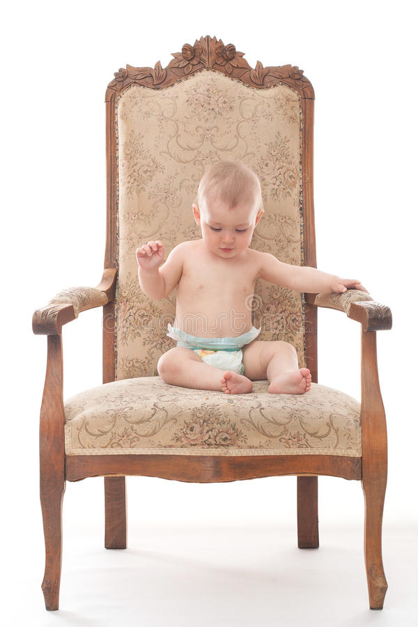 Baby boy on an antique chair royalty free stock photography