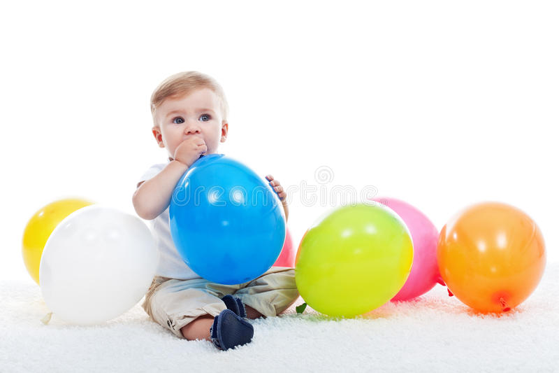 Baby boy with balloons royalty free stock photos