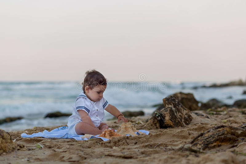 Baby boy on the beach royalty free stock photography