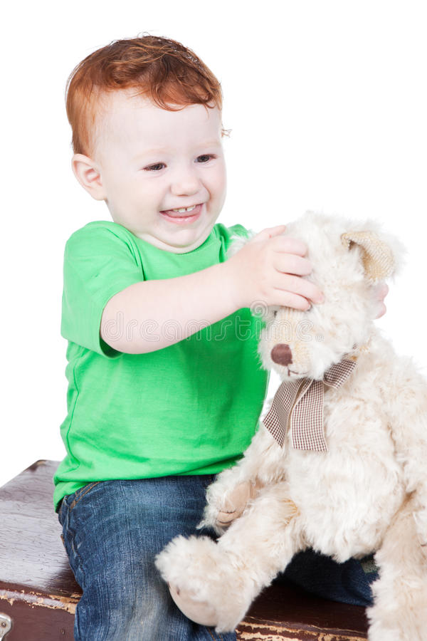 Download Baby boy with bear toy stock image. Image of isolated - 20211457