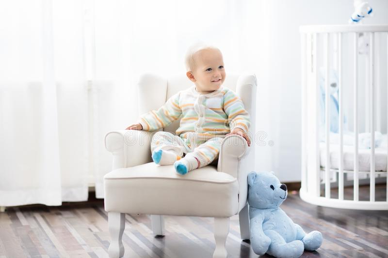 Baby boy in bedroom. Kids room. Bed for child. stock images