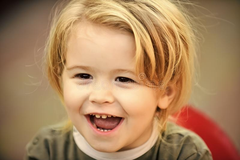Baby boy with blond hair smile on cute face outdoor royalty free stock photo