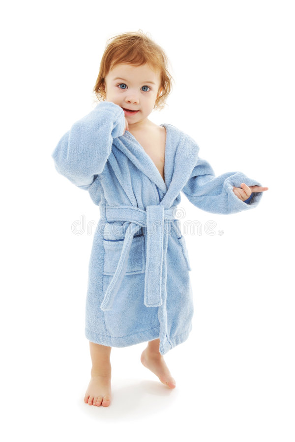 Baby boy in blue robe. Over white stock images