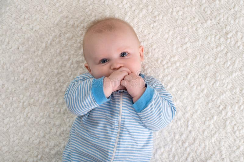 Baby Boy in Blue and White Striped Pajamas royalty free stock photo