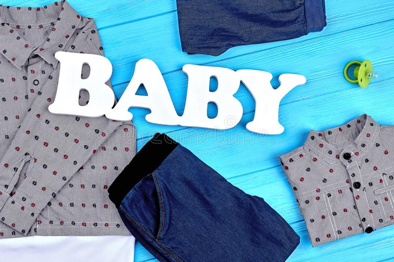 Baby-boy brand clothes background. High quality denim apparel for little boys. Baby modern style attire, top view stock image