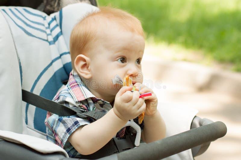 Teething Baby Girl stock image. Image of milestone, hands ...