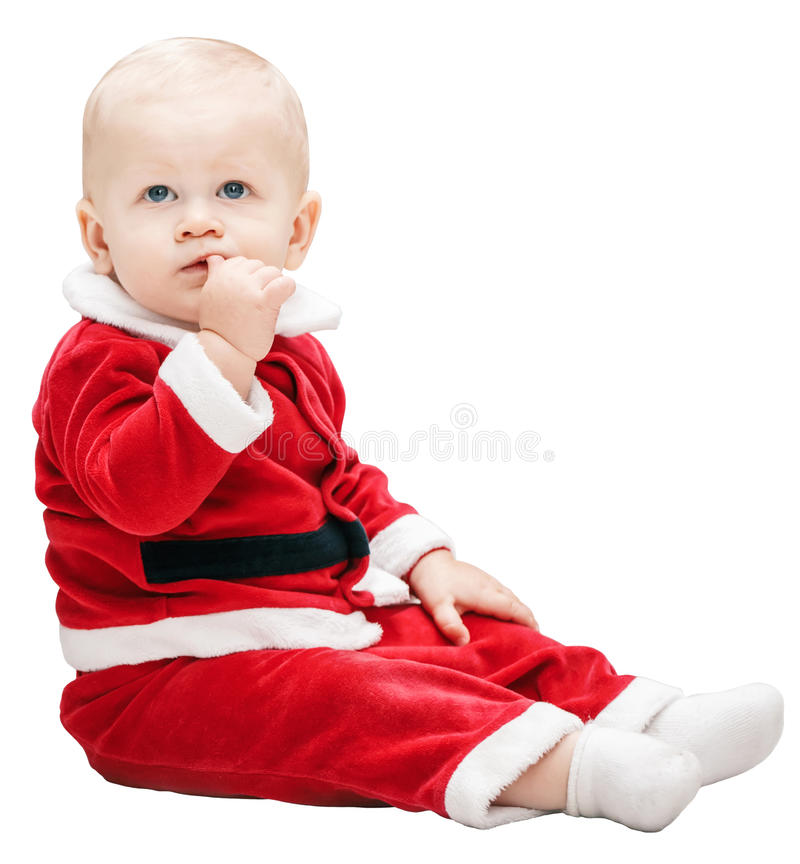 Baby boy child with blue eyes in red Santa Claus costume sitting royalty free stock photo