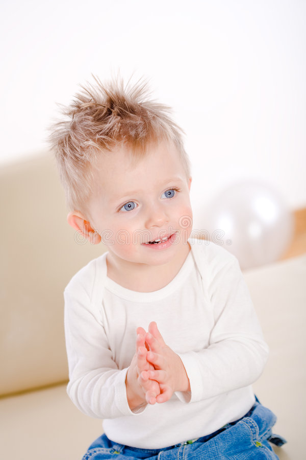 Baby boy clapping royalty free stock photography