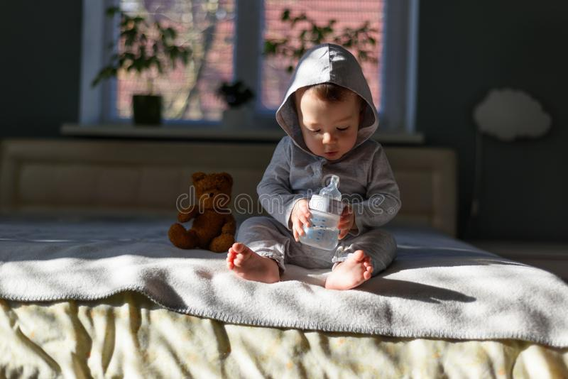 Baby boy with coloured pyramid toy royalty free stock images